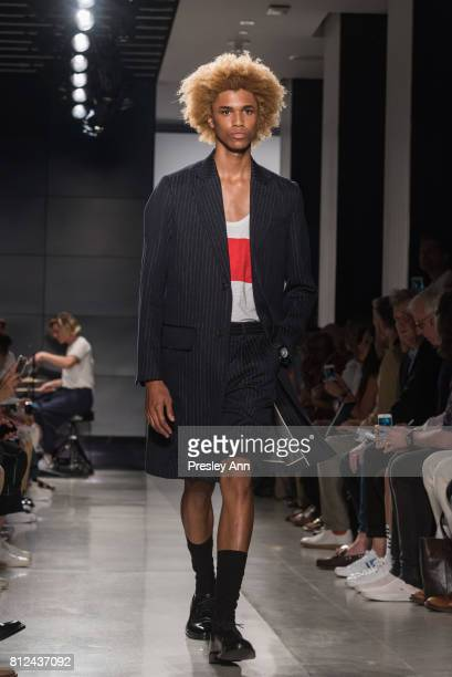 Michael Lockley walks the runway at Todd Snyder Runway NYFW Men's July 2017 at Cadillac House on July 10 2017 in New York City