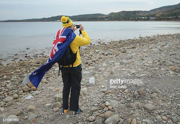 Michael Lockwood a visitor from Australia who had attended the Dawn Service at the Anzac Commemorative Site and has draped himself with an Australian...