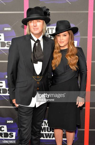 Michael Lockwood and Lisa Marie Presley attend the 2013 CMT Music awards at the Bridgestone Arena on June 5 2013 in Nashville Tennessee