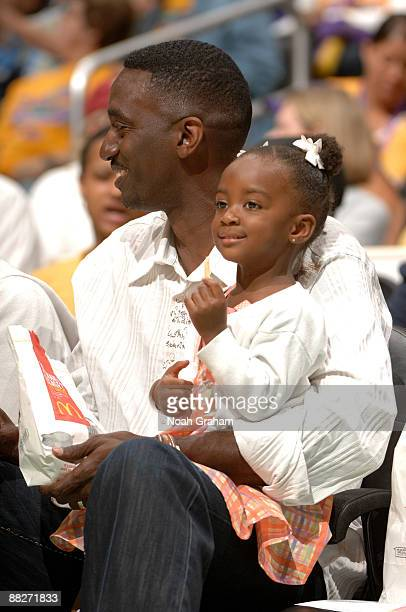 Michael Lockwood husband of Lisa Leslie of the Los Angeles Sparks and their daughter Lauren look on during a game against the Detroit Shock on June 6...
