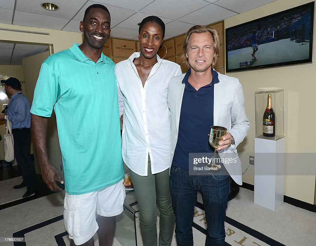 Michael Lockwood, Lisa Leslie-Lockwood and U.S. vice president of Champagne maker Moet & Chandon Ludovic du Plessis attend The Moet & Chandon Suite at USTA Billie Jean King National Tennis Center on August 29, 2013 in New York City.