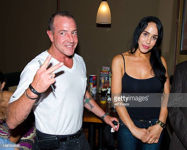 Michael Lohan and Nadya 'Octomom' Suleman pose at the Celebrity Pillow Fight Press Conference and Weigh In at the Fox And Hound Pub and Grille on...