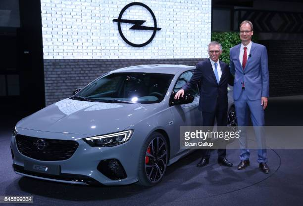 Michael Lohscheller CEO of German carmaker Opel and Carlos Tavares Chairman of PSA Peugeot Citroen stand next to a 2017 Opel Insignia GSi at the 2017...
