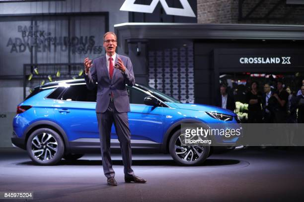 Michael Lohscheller chief executive officer of Adam Opel AG gestures while speaking in front of an Opel Crossland X sports utility vehicle during the...