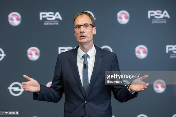 Michael Lohscheller chief executive officer of Adam Opel AG gestures while speaking during a news conference at the Opel factory in Ruesselsheim...