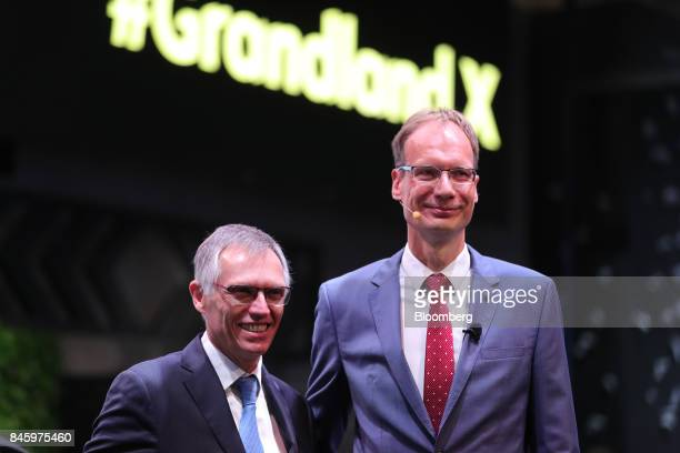 Michael Lohscheller chief executive officer of Adam Opel AG left and Carlos Tavares chief executive officer of PSA Group pose for a photograph during...