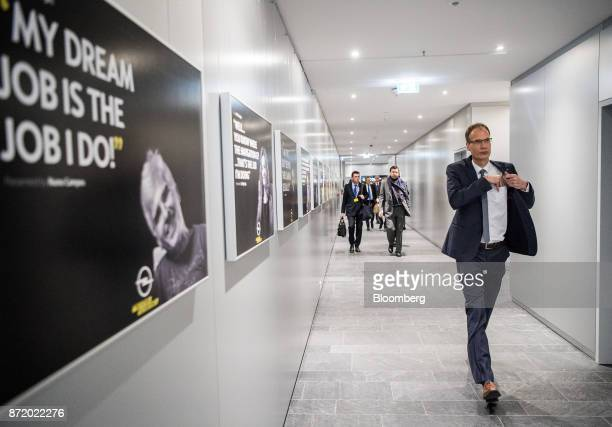 Michael Lohscheller chief executive officer of Adam Opel AG walks down a corridor as he departs a news conference at the Opel factory in Ruesselsheim...
