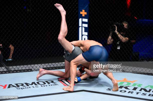 Michael Lombardo attempts to takedown Korey Kuppe in their welterweight bout during week seven of Dana White's Contender Series season four at UFC...