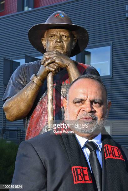 Michael Long supported by his son Jake Long and gradnson speaks to the media infront of a statue of himself at The Hangar at the Essendon Bombers...