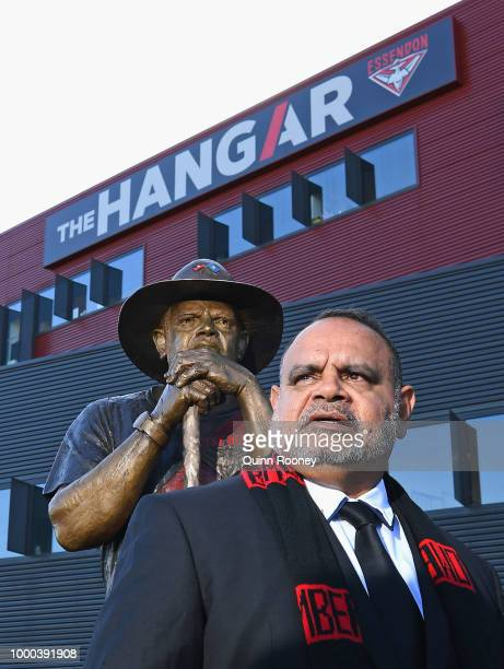 Michael Long poses infront of a statue of himself at The Hangar at the Essendon Bombers Football Club on July 17 2018 in Melbourne Australia Former...