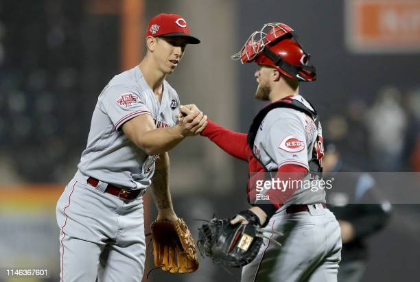 Michael Lorenzen and Tucker Barnhart of the Cincinnati Reds celebrate the win over the New York Mets at Citi Field on May 01 2019 in the Flushing...