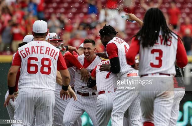 Michael Lorenzen of the Cincinnati Reds celebrates hitting the game winning double against the Arizona Diamondbacks during the ninth inning at Great...