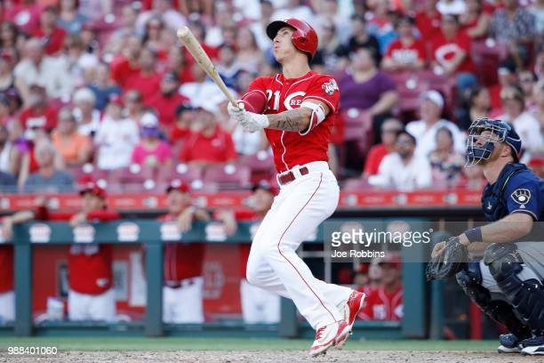 Michael Lorenzen of the Cincinnati Reds hits a grand slam home run while pinch hitting in the seventh inning against the Milwaukee Brewers at Great...
