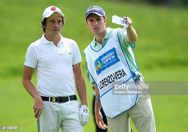 Michael LorenzoVera of France discusses strategy with his caddie on the 18th hole during the second round of the Irish Open on May 16 2008 at the...
