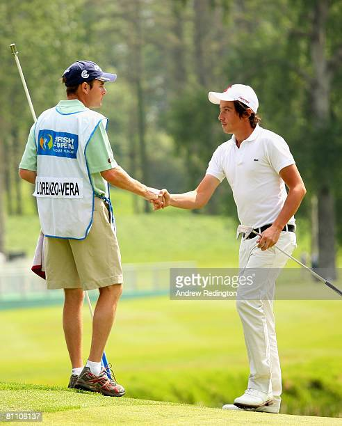 Michael LorenzoVera of France shakes hands with his caddie on the 18th hole during the second round of the Irish Open on May 16 2008 at the Adare...