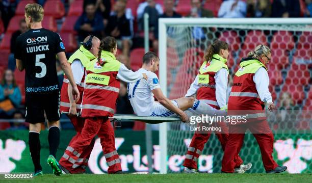 Michael Luftner of FC Copenhagen leaving the pitch injured on a stretcher during the Danish Alka Superliga match between FC Copenhagen and...