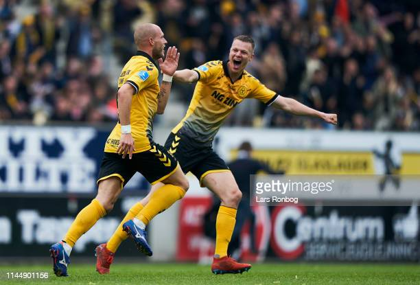 Michael Lumb and Mads Juel Andersen of AC Horsens celebrate after scoring their first goal during the Danish Superliga match between AC Horsens and...