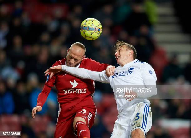 Michael Lumb of Lyngby BK and Martin Pusic of FC Copenhagen compete for the ball during the Danish Alka Superliga match between FC Copenhagen and...