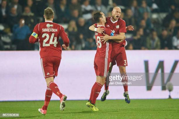 Michael Lumb of Lyngby BK and teammates celebrate after his 01 goal during the Danish Alka Superliga match between AGF Arhus and Lyngby BK at Ceres...