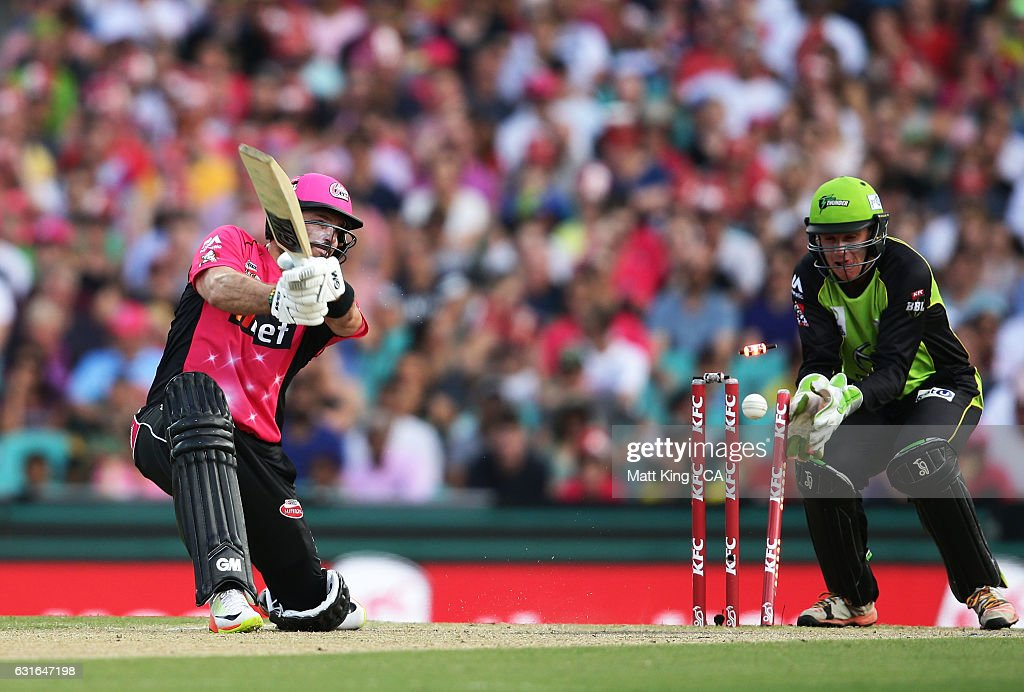 Michael Lumb of the Sixers is bowled by Chris Green of the Thunder during the Big Bash League match between the Sydney Sixers and the Sydney Thunder at Sydney Cricket Ground on January 14, 2017 in Sydney, Australia.