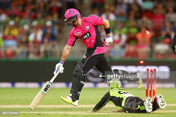 Michael Lumb of the Sixers slides in to avoid a runout during the Big Bash League match between the Sydney Thunder and the Sydney Sixers at Spotless...