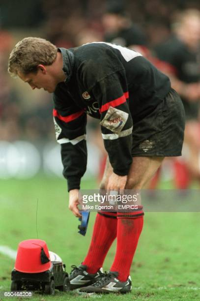 Michael Lynagh of Saracens takes the kicking tee from a remote control car
