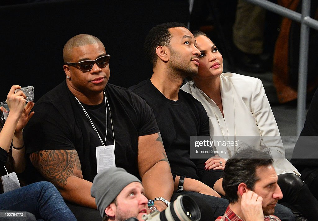 Michael Lynche, John Legend and Chrissy Teigen attend the Los Angeles Lakers vs Brooklyn Nets game at Barclays Center on February 5, 2013 in the Brooklyn borough of New York City.