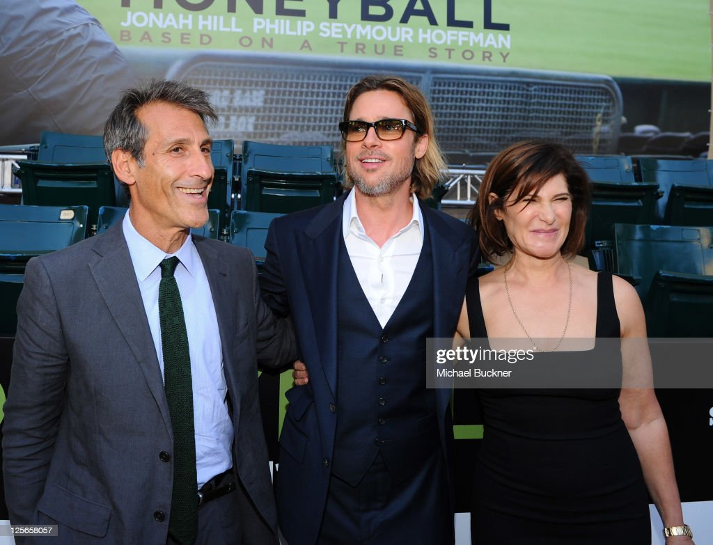 Michael Lynton, Chairman and Chief Executive Officer of Sony Pictures Entertainment, actor Brad Pitt and Amy Pascal, Co-Chairman of Sony Pictures Entertainment, arrive at the premiere of Columbia Pictures' 'Moneyball' at the Paramount Theatre of the Arts on September 19, 2011 in Oakland, California.
