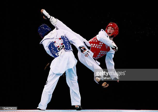 Michael Magee of Australia in action against Levent Tuncat of Germany during the Taekwondo preliminary round at the London Prepares LOCOG Test Event...