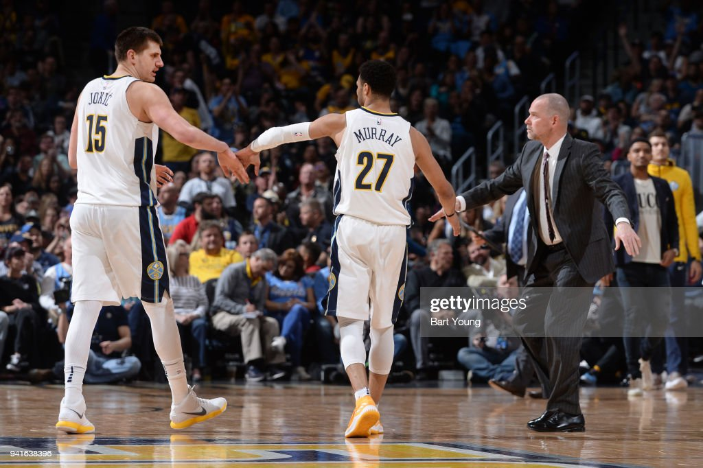 Michael Malone, Nikola Jokic #15 , and Jamal Murray #27 of the Denver Nuggets high five during the game against the Indiana Pacers on April 3, 2018 at the Pepsi Center in Denver, Colorado.