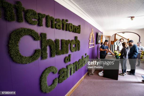 Michael Malone of Miami Florida checks the ages of visitors at the opening of the International Church of Cannabis on April 20 2017 in Denver...