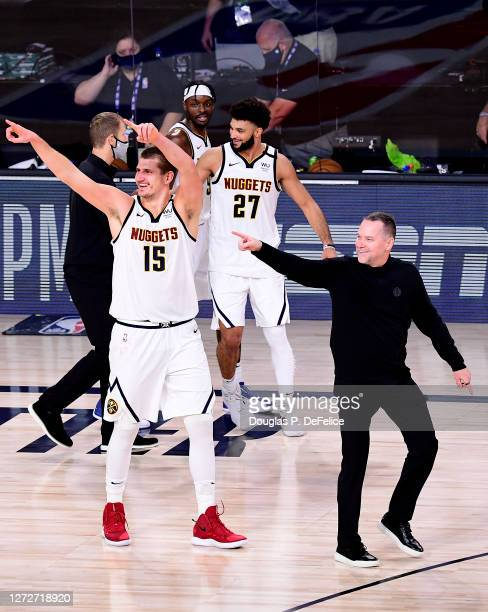 Michael Malone of the Denver Nuggets, Nikola Jokic of the Denver Nuggets and Jamal Murray of the Denver Nuggets celebrate their win over LA Clippers...