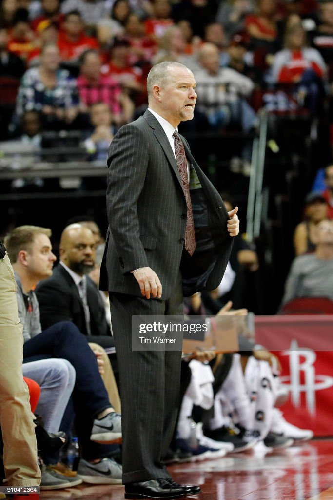 Michael Malone of the Denver Nuggets reacts on the bench in the first half against the Houston Rockets at Toyota Center on February 9, 2018 in Houston, Texas.