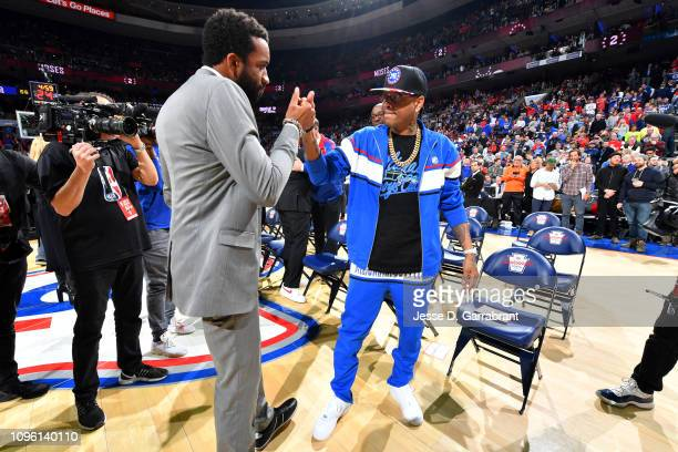 Michael Malone the son of Moses Malone and NBA legend Allen Iverson shake hands during Moses Malone's jersey retirement ceremony during the game...