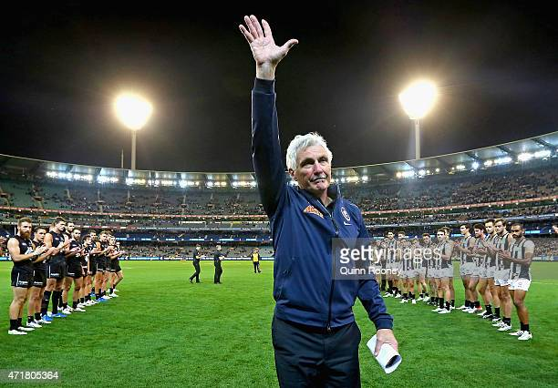 Michael Malthouse the coach of the Blues acknowledges the crowd after breaking the record for the most games coached during the round five AFL match...