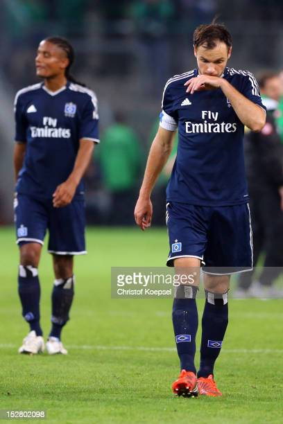 Michael Mancienne and Heiko Westermann of Hamburg look dejected after the 22 draw of the Bundesliga match between Borussia Moenchengladbach and...