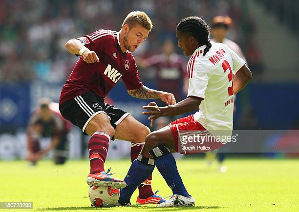 Michael Mancienne of Hamburg and Alexander Esswein of Nuernberg compete for the ball during the Bundesliga match between Hamburger SV and 1 FC...