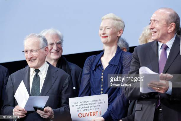 Michael Mann Tilda Swinton and Gerard Collomb attends the opening ceremony of 9th Film Festival Lumiere In Lyon on October 14 2017 in Lyon France