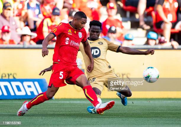 Michael Maria of United competes for the ball with Mohamad Adam of the Wanderers during the round 12 A-League match between Adelaide United and the...