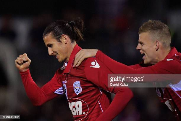 Michael Marrone celebrates with Jordan Elsey of United after scoring a goal during the round of 32 FFA Cup match between Adelaide United and the...