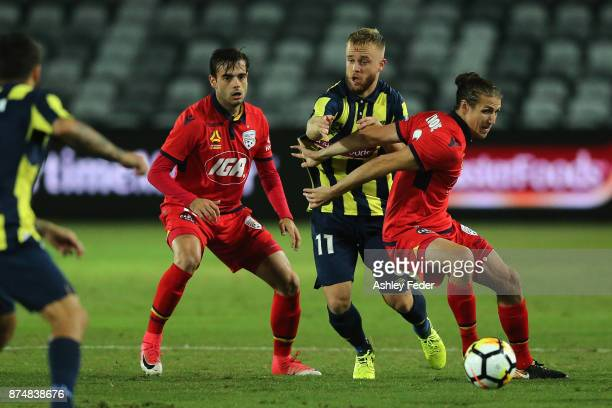Michael Marrone of Adelaide is contested by Connor Pain of the Mariners during the round seven ALeague match between the Central Coast Mariners and...