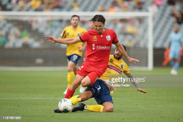 Michael Marrone of Adelaide United contests the ball against Milan Duric of the Central Coast Mariners during the round 6 ALeague match between the...