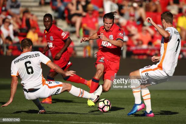 Michael Marrone of Adelaide United runs with the ball during the round 23 ALeague match between Adelaide United and the Brisbane Roar at Coopers...