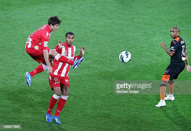 Michael Marrone of the Heart kicks past teammate Patrick Gerhardt and Henrique of the Roa during the round six ALeague match between the Melbourne...