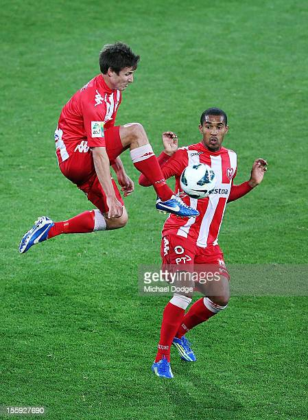 Michael Marrone of the Heart kicks past teammate Patrick Gerhardt during the round six ALeague match between the Melbourne Heart and the Brisbane...
