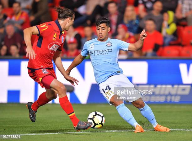 Michael Marrone of United competes for the ball with Daniel Arzani of Melbourne City during the round 23 ALeague match between Adelaide United and...