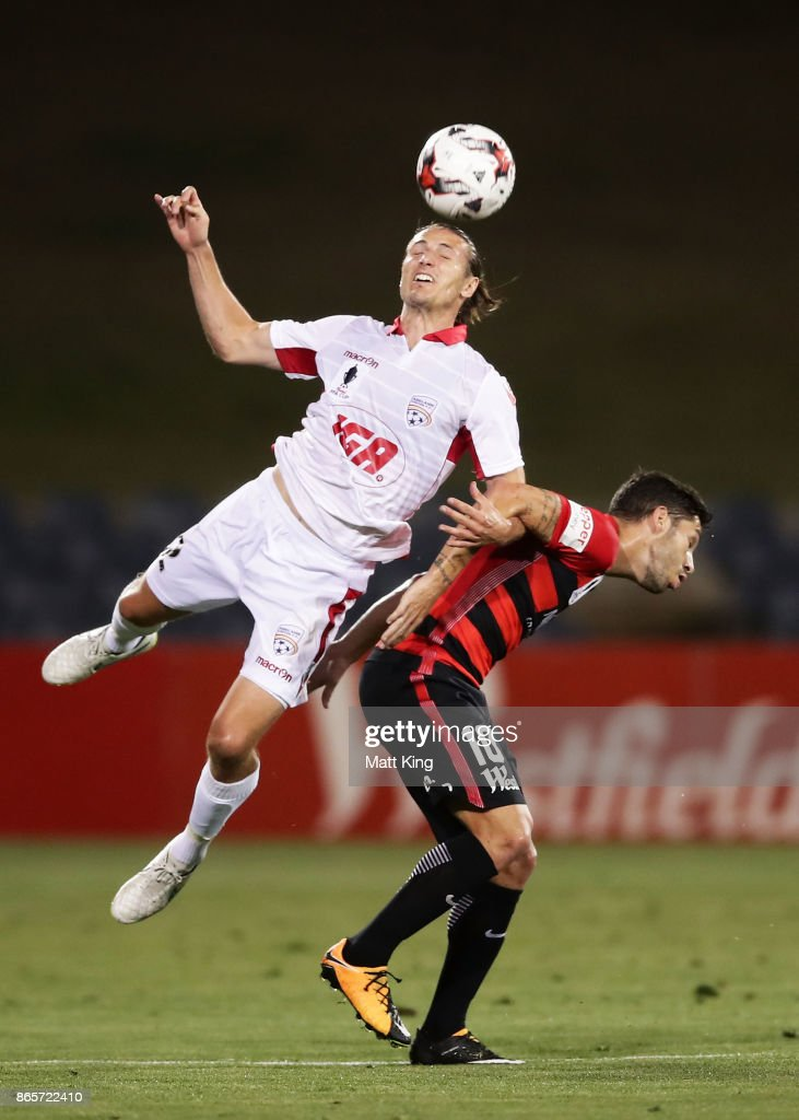 Michael Marrone of United is challenged by Alvaro Cejudo of the Wanderers during the FFA Cup Semi Final match between the Western Sydney Wanderers and Adelaide United at Campbelltown Sports Stadium on October 24, 2017 in Sydney, Australia.