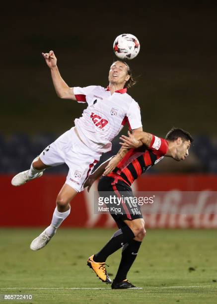Michael Marrone of United is challenged by Alvaro Cejudo of the Wanderers during the FFA Cup Semi Final match between the Western Sydney Wanderers...