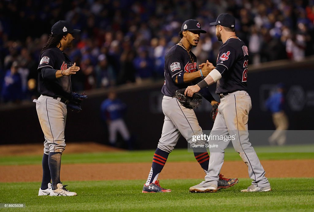 Michael Martinez #1, Francisco Lindor #12 and Jason Kipnis #22 of the Cleveland Indians celebrate after beating the Chicago Cubs 1-0 in Game Three of the 2016 World Series at Wrigley Field on October 28, 2016 in Chicago, Illinois.