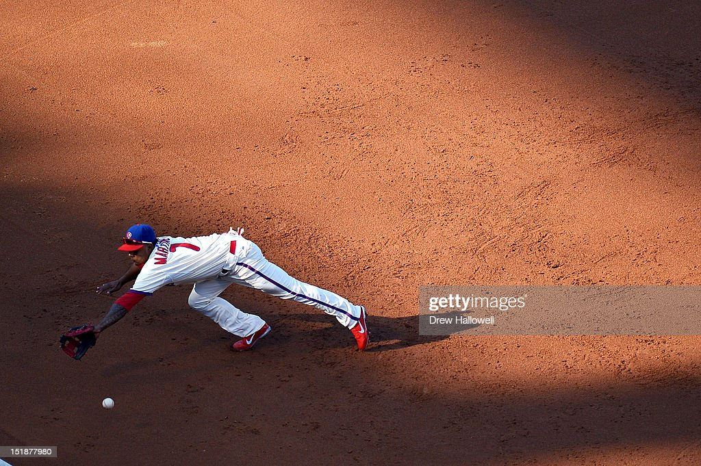 Michael Martinez #7 of the Philadelphia Phillies dives for the ball during the game against the Miami Marlins at Citizens Bank Park on September 12, 2012 in Philadelphia, Pennsylvania.